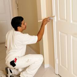 An interior painting contractor detailing a home with paint in Brookfield
